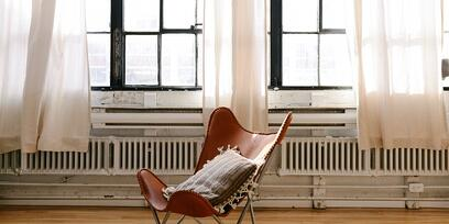 Modern Wooden Chair in Apartment in Font on Large Picture Windows