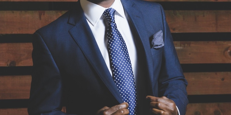 Young Professional Dressed in Blue Suit and Tie