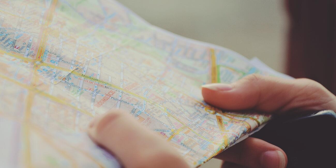 Close up of hands holding a map