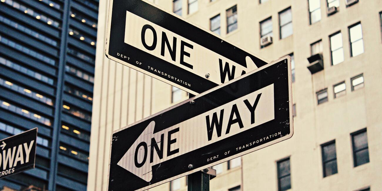 Two street signs pointing in opposite directions