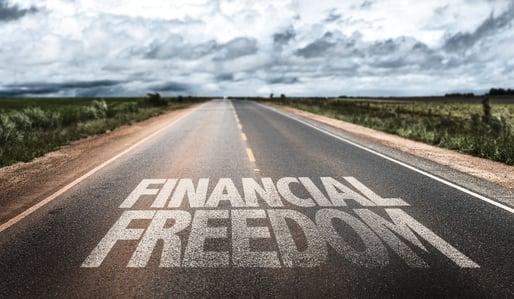 Financial Freedom written on rural road-1